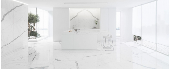Room featuring a countertop and floor and wall tiles inclusing the mookmatch tile XLIGHT Kala White by Porcelanosa